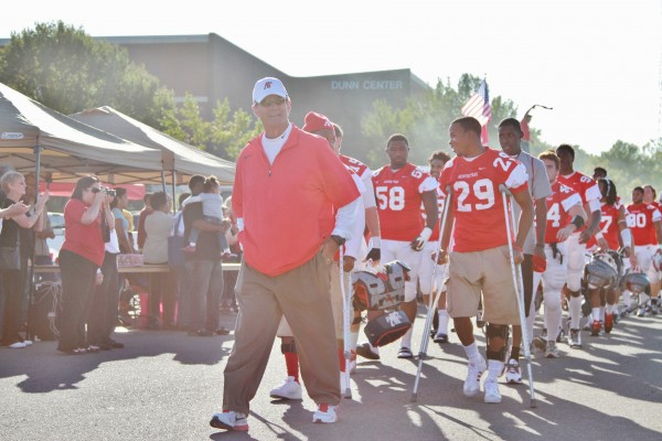 Former coach Rick Christophel leading the Govs football team down Tailgate Alley before their game | Brittney Sparn Editor-In-Chief of the Monocle