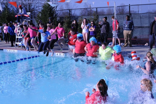Participants jump into the Foy Center pool during the Polar Plunge Thursday, Jan. 31.