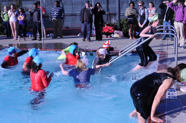 Participants rush out of the cold water after the plunge.