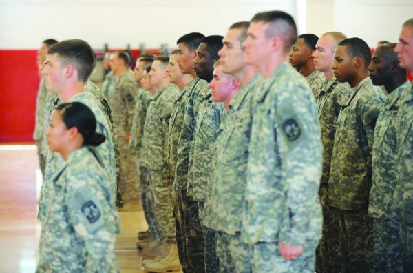 Cadets in APSU's ROTC Governors Guard stand in attention. File Photo