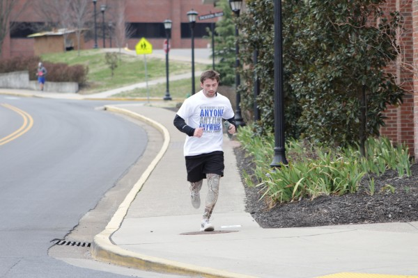 John Wesley running in the Clarksville Walk for Brain Injury, just before he crossed the finish line.  Brittaney Abbott | staff photographer
