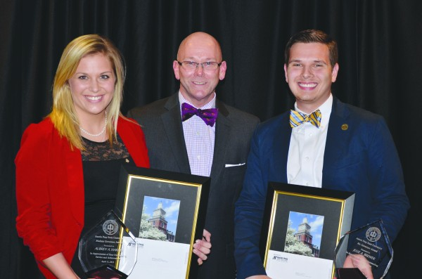 Aubrey Harris, recipient of the Madam Governor Award (left), and Jesse Brewer, recipient of the Mr. Governor Award (right), pose with Gregory Singleton, Associate Vice President and Dean of Students (center). Josh Vaughn | Photo Editor