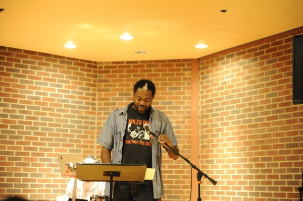 Johnny Jones, assistant professor of African American studies, recites poetry to break the ice at the third annual Peay Soup Spoken Word Competition on Tuesday, April 16.    Janay Neal  | staff photographer