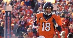 Denver Broncos quarterback Peyton Manning runs onto the field for the first half the NFL football AFC Championship game between the Denver Broncos and the New England Patriots, Sunday, Jan. 24, 2016, in Denver. (AP Photo/Charlie Riedel)