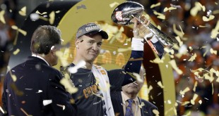 Denver Broncos� Peyton Manning (18) holds up the trophy after the NFL Super Bowl 50 football game Sunday, Feb. 7, 2016, in Santa Clara, Calif. The Broncos won 24-10. (AP Photo/Julie Jacobson)