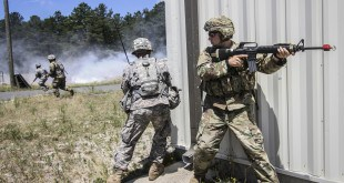 Soldiers provide cover for one another while crossing a field under simulated enemy fire during Exercise Gridiron at Joint Base McGuire-Dix-Lakehurst, N.J., June 27, 2016. The soldiers are reservists assigned to the 404th Civil Affairs Battalion. Air National Guard photo by Tech. Sgt. Matt Hecht