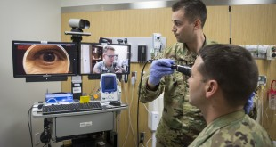 In a demonstration of the virtual health process, Lt. Col. Kevin A. Horde, a     provider at Fort Gordon's Eisenhower Medical Center, offers remote     consultation to mock patient Master Sgt. Jason H. Alexander with the nursing     assistance of Lt. Maxx P. Mamula at Fort Campbell's Blanchfield Army     Community Hospital. (U.S. Army photo by David E. Gillespie/RELEASED)