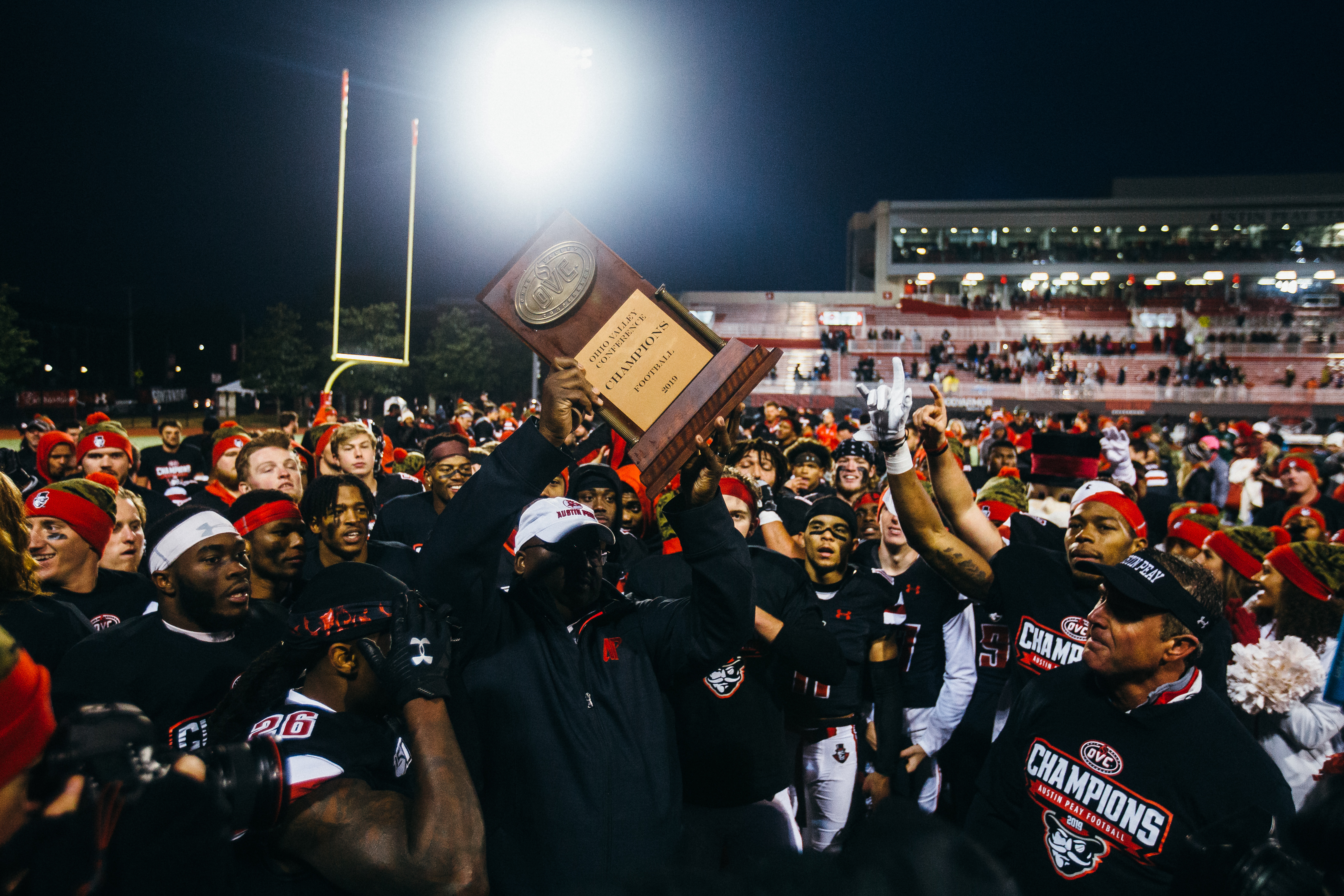 The APSU football team, alongside former head coach Mark Hudspeth, celebrate their 2019 OVC championship. | THE ALL STATE ARCHIVES
