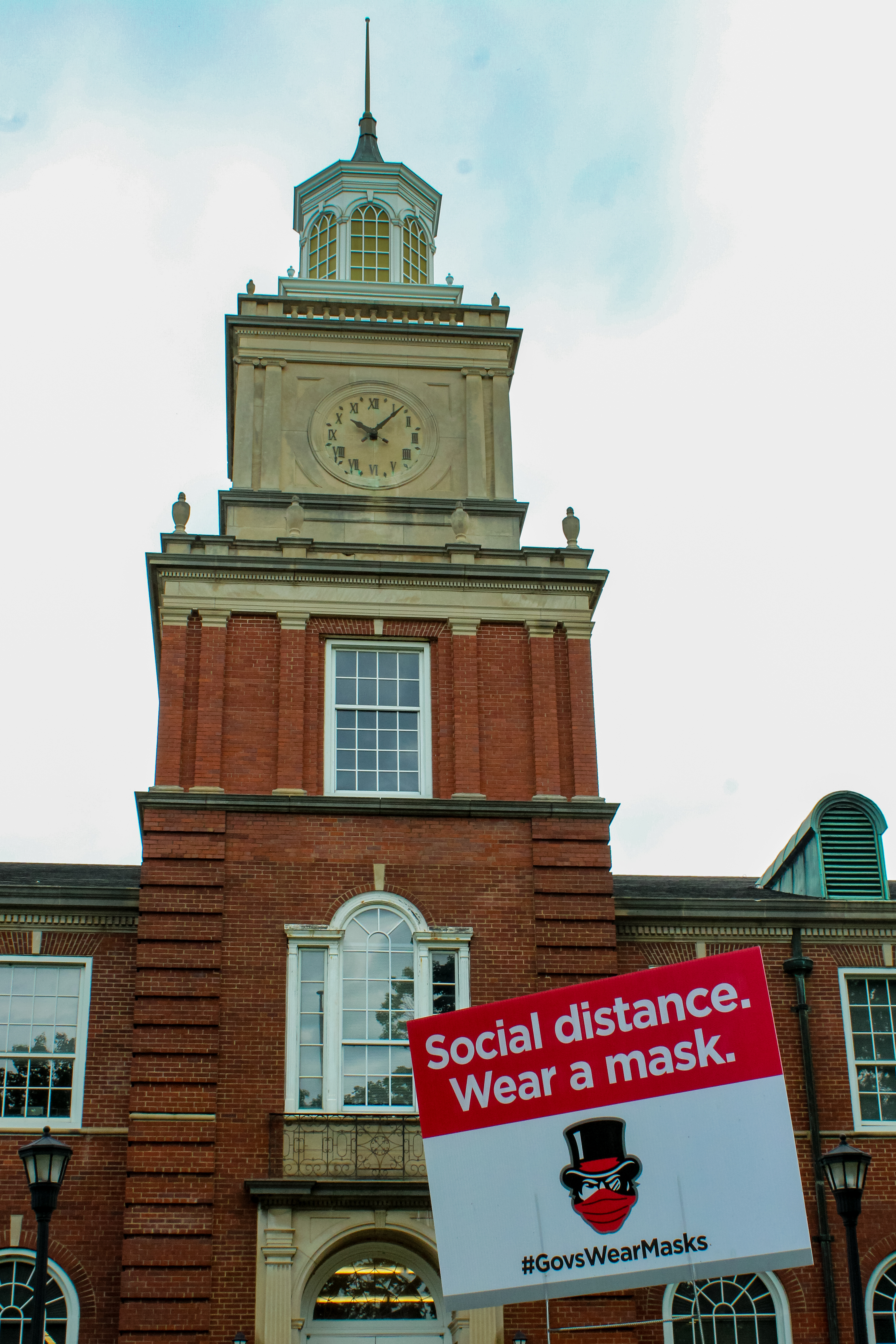 "A sign calling members of the Clarksville community to ""Social distance"" and ""Wear a mask"" is seen in front of the Browining building. NICHOLE BARNES 