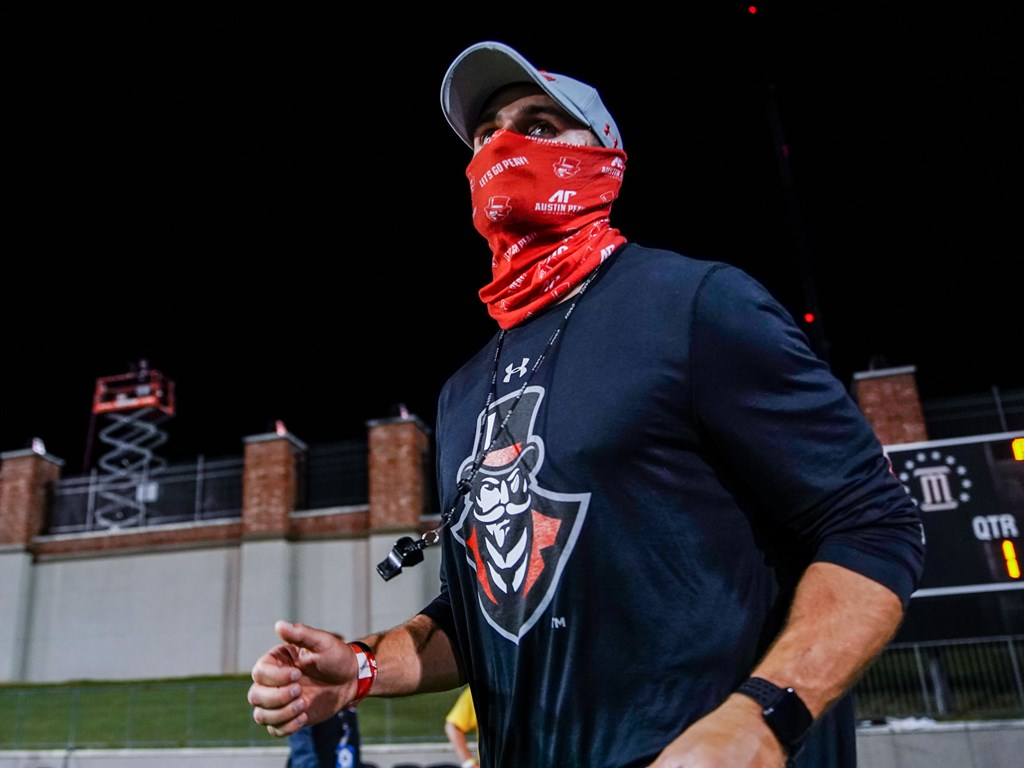 A masked member of the APSU football coaching staff trots onto the field before their game against Central Arkansas. ERIC ELLIOT | APSU SPORTS INFORMATION