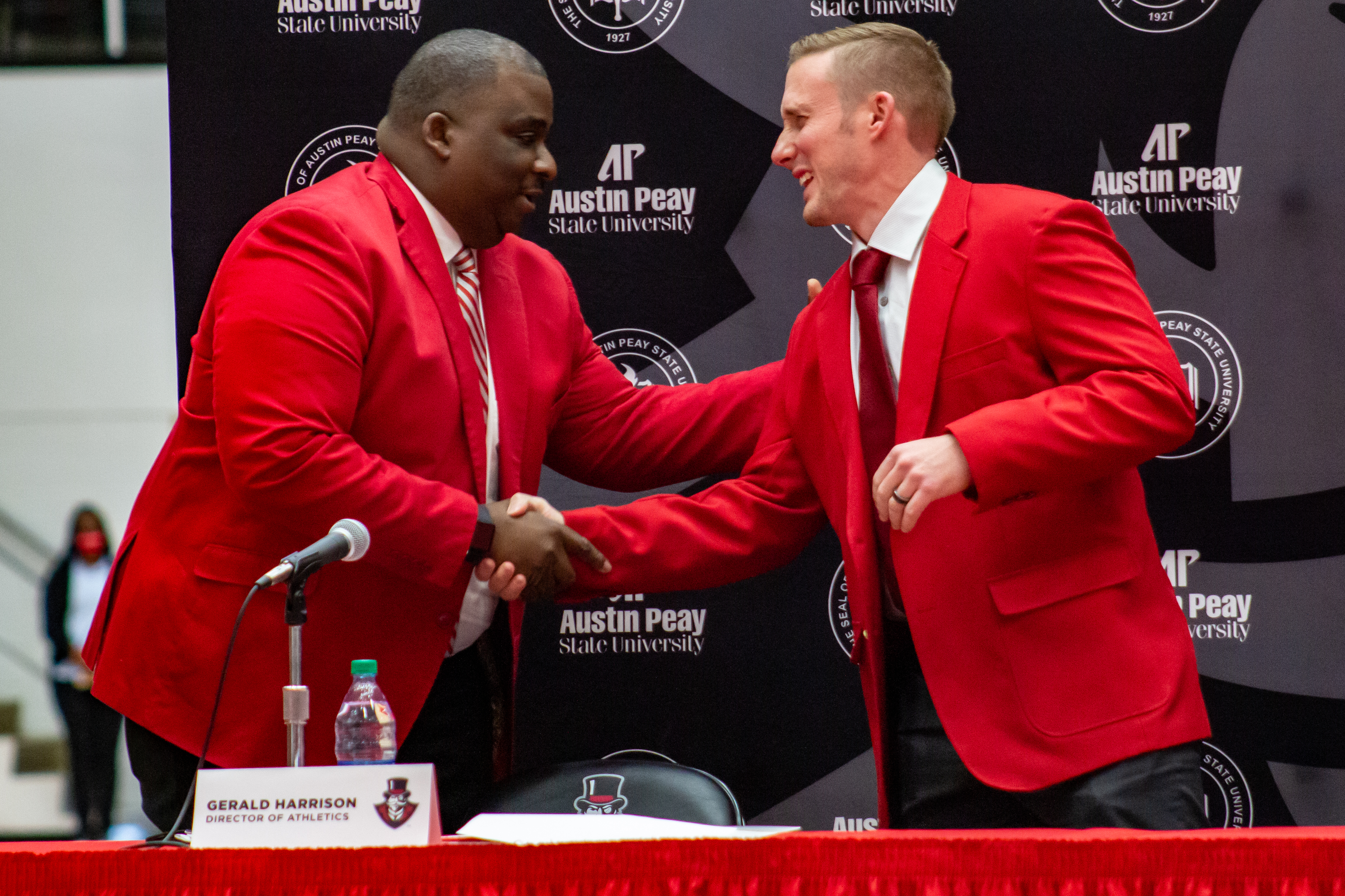 Scotty Walden receives a red jacket from Gerald Harrison at his introductory press conference. NICHOLE BARNES | THE ALL STATE