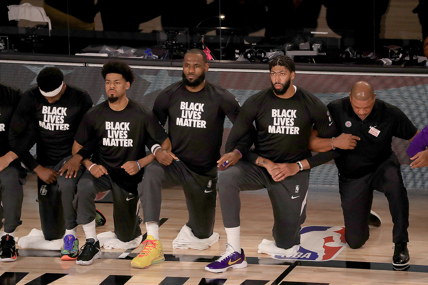 LeBron James kneels alongside teammates and coaches during the 2020 NBA playoffs MIKE EHRMANN   GETTY IMAGES