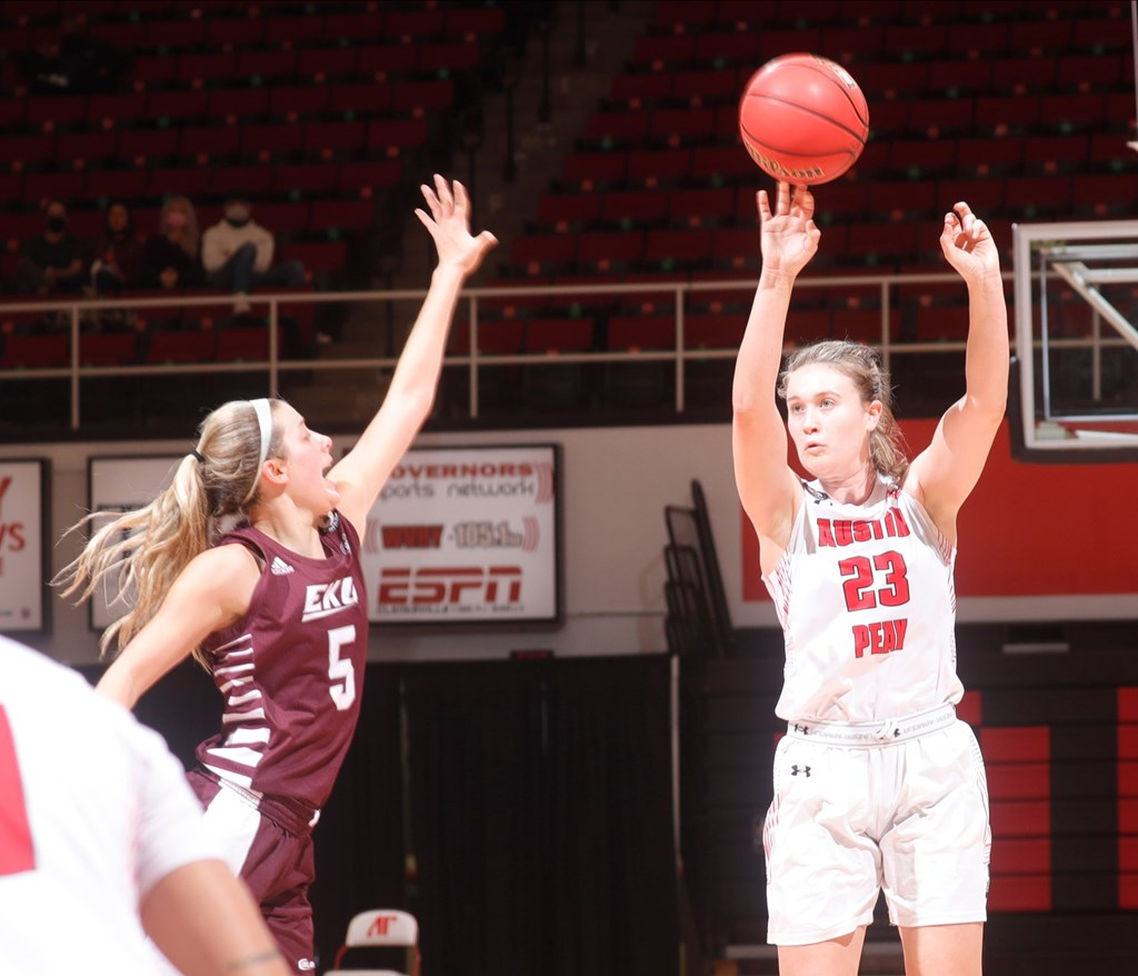 Maggie Knowles attempts a three-point shot over Eastern Kentucky's Amerah Steele. ROBERT SMITH | APSU SPORTS INFORMATION