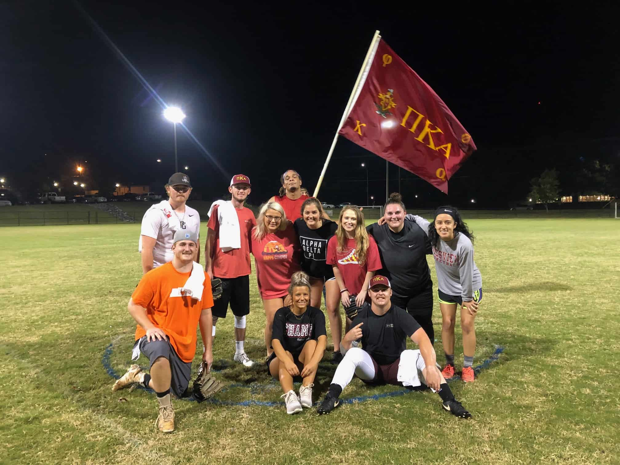 Students pose after being crowned champions of the 2019 fall softball intramural league