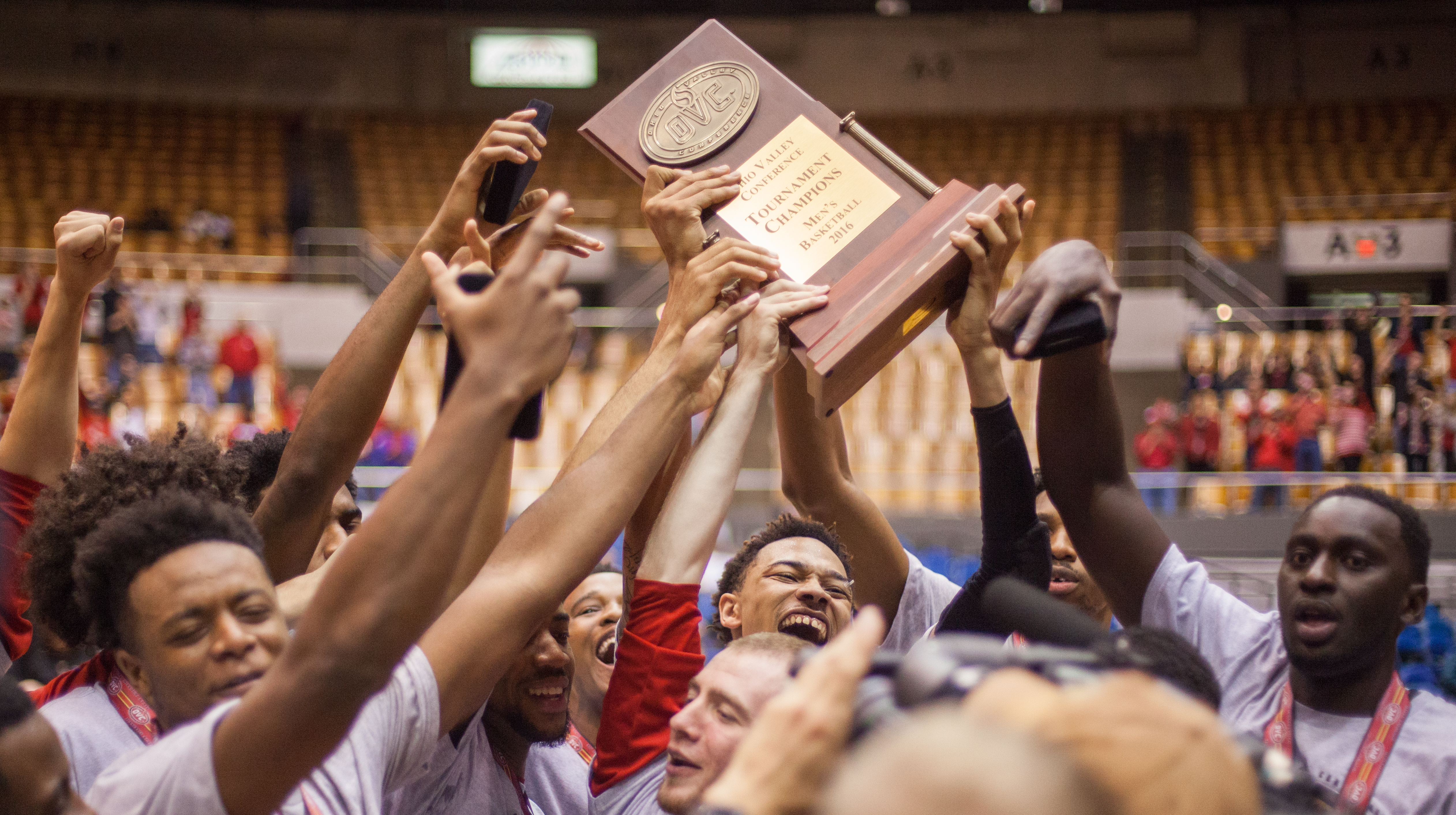 The APSU men's basketball team hoists the 2016 OVC Tournament Championship. | THE ALL STATE ARCHIVES
