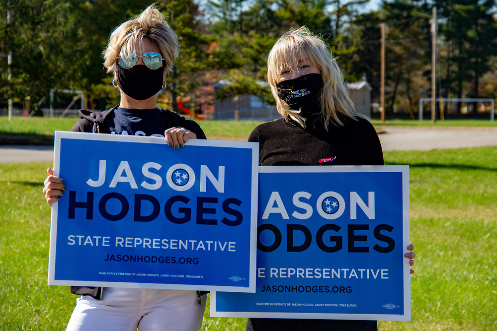 Emily Wilcox and Linda Crenshaw hold signs supporting Jason Hodges for state representative. NICHOLE BARNES | THE ALL STATE