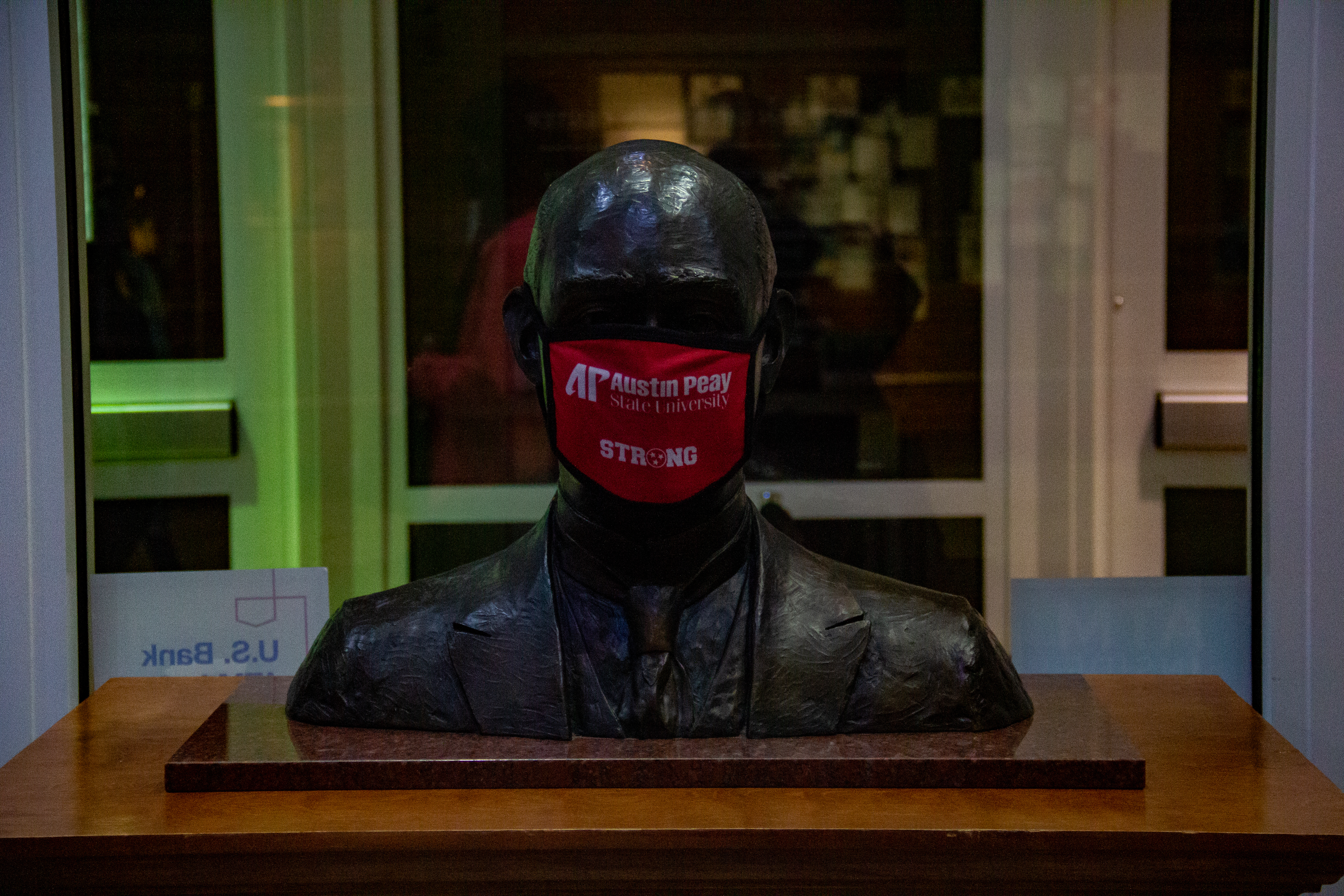 A bust inside the Morgan University Center is seen wearing a mask. NICHOLE BARNES   THE ALL STATE