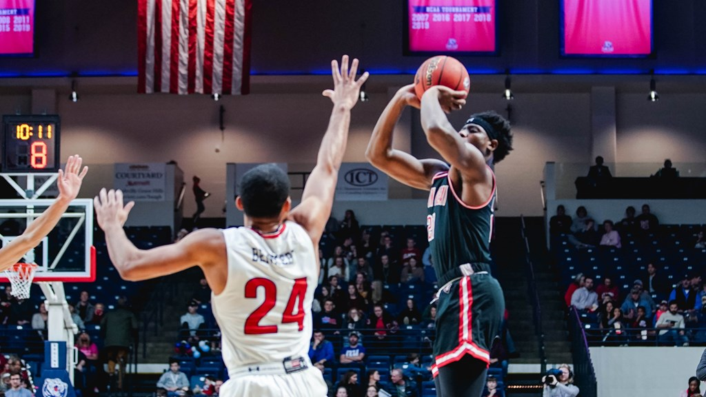 OVC Preseason POTY Terry Taylor shoots over a Belmont defender in 2019. ERIC ELLIOT | APSU SPORTS INFORMATION