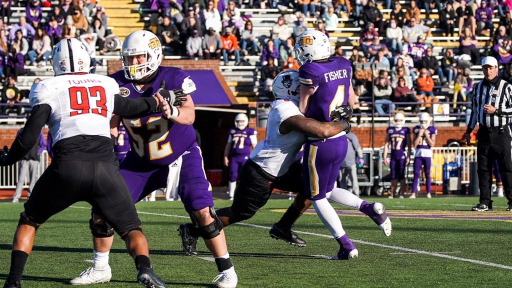 An APSU defender applies pressure to Tennessee Tech quarterback Bailey Fisher. CASEY CRIGGER | APSU ATHLETICS