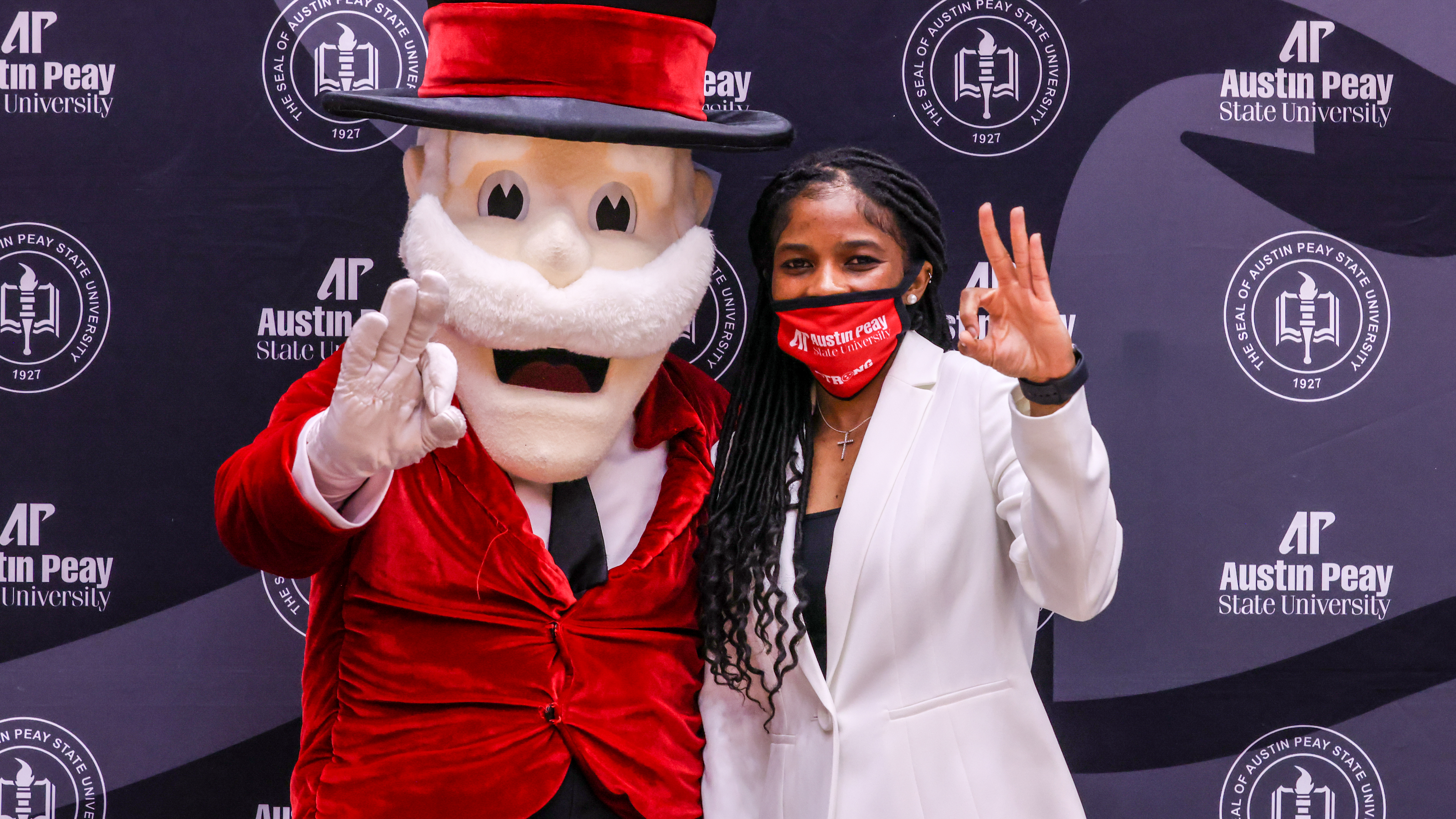 Brittany Young poses with an APSU mascot during her introductory press conference. ERIC ELLIOT | APSU ATHLETICS